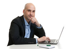 Busy businessman working on his laptop Stock Photos