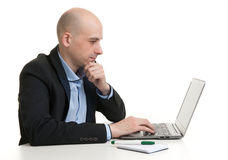 Busy businessman working on his laptop Stock Images