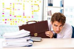 The busy businessman working in the office stock images
