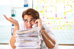 The busy businessman working in the office stock photos