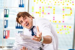The busy businessman working in the office royalty free stock photo