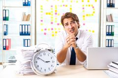 The busy businessman working in the office stock image