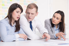 Busy businesspeople in corporation. Three young busy businesspeople having problems at work in corporation Stock Images