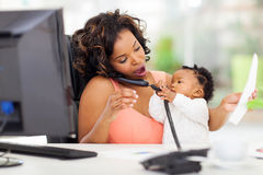 Busy businesswoman baby Royalty Free Stock Photography