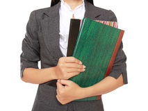 Busy businesswoman carrying a lot of books Stock Photography