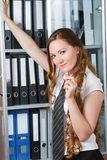 Busy businesswoman with folder Stock Photos
