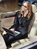Busy businesswoman with laptop l Stock Photography