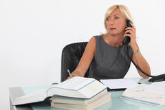 A busy businesswoman. Stock Images