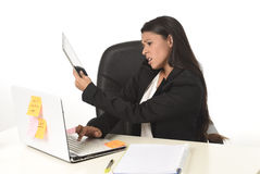Busy businesswoman suffering stress working at office computer desk worried desperate Royalty Free Stock Photos