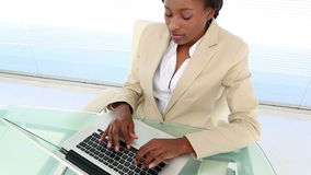 Busy businesswoman using laptop at desk stock video footage