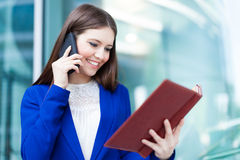 Busy businesswoman at work Royalty Free Stock Images