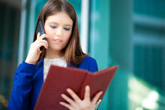 Busy businesswoman at work Royalty Free Stock Image