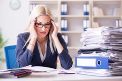 The busy businesswoman working in office at desk. Busy businesswoman working in office at desk Royalty Free Stock Photos