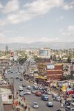 Busy, bustling city street in Ethiopia. Full of cars, dust, and African business men and women royalty free stock photos