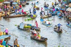 Busy bustling scene on living morning floating market Stock Image
