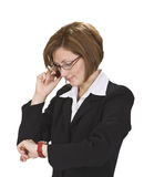 Busy call. Busy businesswoman checking the time while calling Royalty Free Stock Photography
