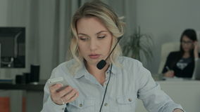 Busy call operator dealing with a lot of phone calls stock video footage