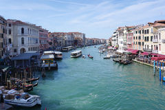Busy canel port with goods ship and people walking in Venice Stock Photography