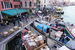 Busy canel port with goods ship and people walking in Venice Royalty Free Stock Photos