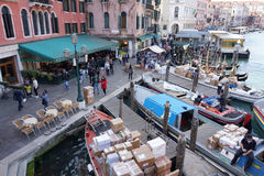 Busy canel port with goods ship and people walking in Venice Royalty Free Stock Images
