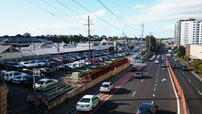 A Busy Car Park Between A Station And Highway Stock Images