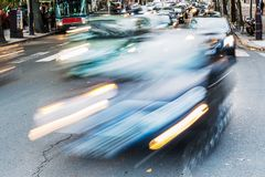 Car traffic on a Parisian street in motion blur Royalty Free Stock Images