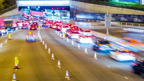 Busy Cars Going Into Tunnel. Tilt Up Shot. Stock Photography