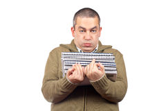 Busy casual man. Carrying stacked files over a white background Stock Photography