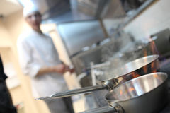 Busy chefs at work in the restaurant kitchen Royalty Free Stock Images