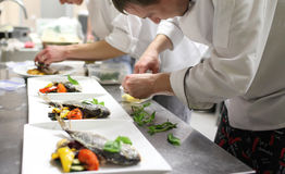 Busy chefs at work in the restaurant kitchen Stock Image