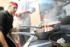 Busy chefs at work in the restaurant kitchen Royalty Free Stock Image