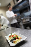 Busy chefs at work in the restaurant kitchen Stock Photography