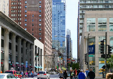 Busy Chicago. Chicago, USA - May 24, 2014: Intersection of East Ohio Street and North Michigan Avenue in Chicago with lots of pedestrians and some cars passing Stock Image