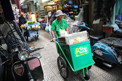 Busy Chinatown Street. A vendor makes his way along a busy street in Chinatown on February 4, 2012 in Bangkok, Thailand. Chinese began settling in the Thai Royalty Free Stock Images
