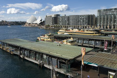 Busy Circular Quay Sydney. Busy Circular Quay with ferries coming and going with the toaster and Opera house in background stock image