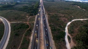 The busy city aerial tracking, road junction, traffic jam stock footage