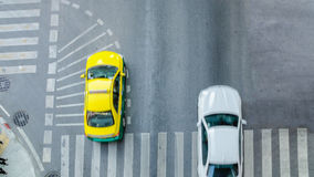 Busy city car are passing pedestrian crossing on traffic road. (Aerial photo, top view Stock Images