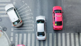 Busy city car are passing pedestrian crossing on traffic road. (Aerial photo, top view Royalty Free Stock Photo