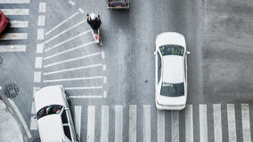 Busy city car are passing pedestrian crossing on traffic road. (Aerial photo, top view Royalty Free Stock Photography