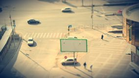 Busy city crossroad with moving cars and pedestrians. Time lapse. Old film and tilt shift effect stock video