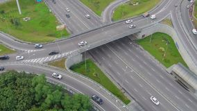 Busy city highway, overpass, fast-driving cars view from above. Stock footage stock footage
