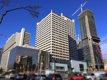 Busy city intersection with construction and traffic in Toronto, Canada. Panoramic view on busy city intersection with construction, traffic, tree branch in Royalty Free Stock Photo