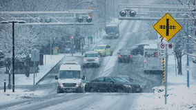 Busy City Intersection In Snowstorm stock footage