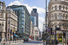 Busy city of London street, leading to the Bank of England. LONDON, UK - JUNE 30, 2014: Busy city of London street, leading to the Bank of England Royalty Free Stock Image
