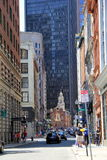 Busy city street with people walking towards the O Royalty Free Stock Image