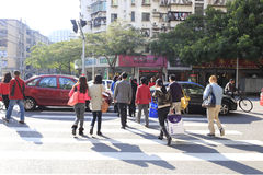 Busy city street people on zebra crossing Stock Photos