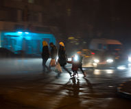 Busy city street people on zebra crossing at night Stock Image