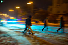 Busy city street people on zebra crossing at night Stock Photo