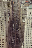 Busy city street with skyscrapers and car traffic. View from the top. Royalty Free Stock Image