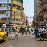 Busy city street with thousands of people in Kolkata, India Royalty Free Stock Images